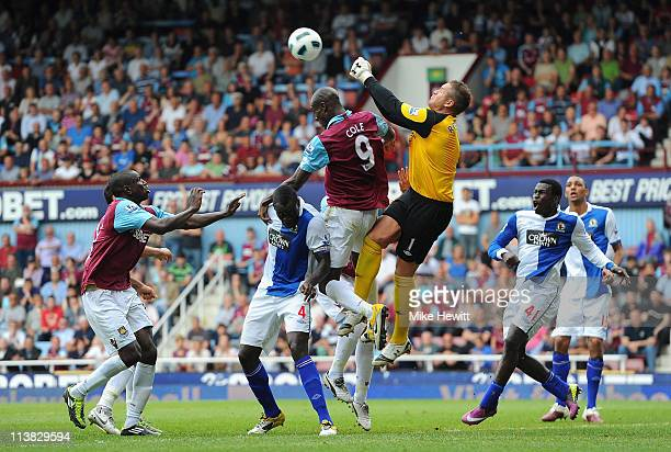 Paul Robinson of Blackburn Rovers punches the ball ahead of Carlton Cole of West Ham United during the Barclays Premier League match between West Ham...