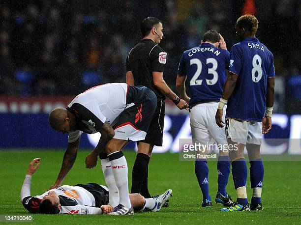Paul Robinson of Bolton Wanderers lies injured after clashing with Seamus Coleman of Everton during the Barclays Premier League match between Bolton...
