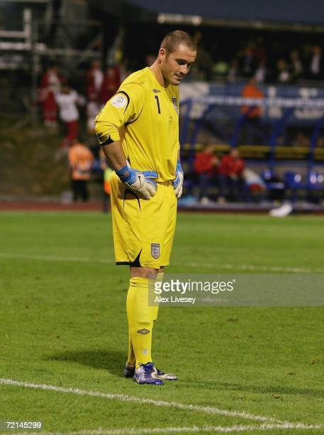 Paul Robinson of England looks at the pitch after miss kicking a back pass to let the ball roll in for the second goal during the Euro2008 Qualifier...
