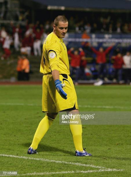 Paul Robinson of England looks in despair at a divot in the pitch after miss kicking a back pass to let the ball roll in for the second goal during...