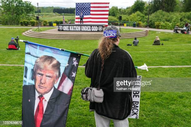Paul Roblyer of Portland holds a flag with the face of former President Donald Trump during a 2nd Amendment rally on May 1, 2021 in Salem, Oregon....
