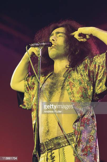 Paul Rodgers singer with British rock band Bad Company singing into a microphone during a live concert performance at Olympia in London England Great...