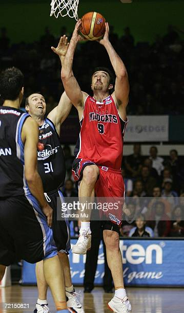 Paul Rogers of the Wildcats reaches up to dunk the ball during the round four NBL game between the New Zealand Breakers and the Perth Wildcats at...