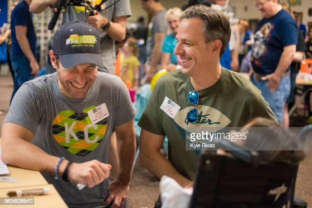 Paul Rudd and Jake Tapper play with a patient at Children's Mercy Hospital during the Big Slick Celebrity Weekend benefitting Children's Mercy...