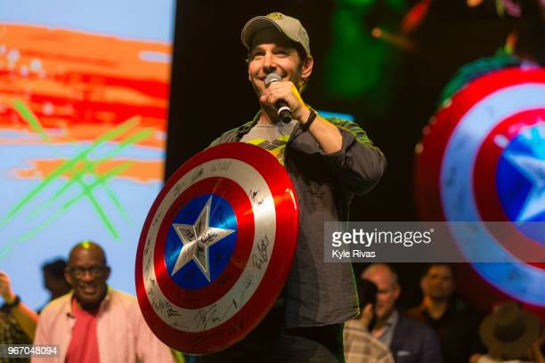 Paul Rudd auctions off a Captain America shield signed by all of the Avengers cast in the Celebrity Auction at Midland Theater during the Big Slick...
