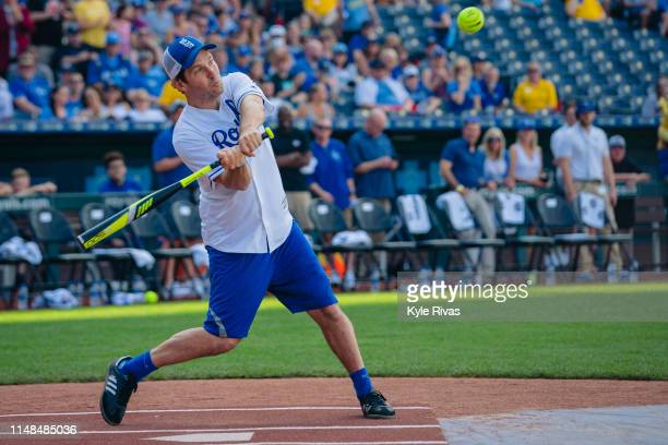 Paul Rudd connects a pitch while playing in the celebrity softball game at Kauffman Stadium during the Big Slick Celebrity Weekend benefiting...