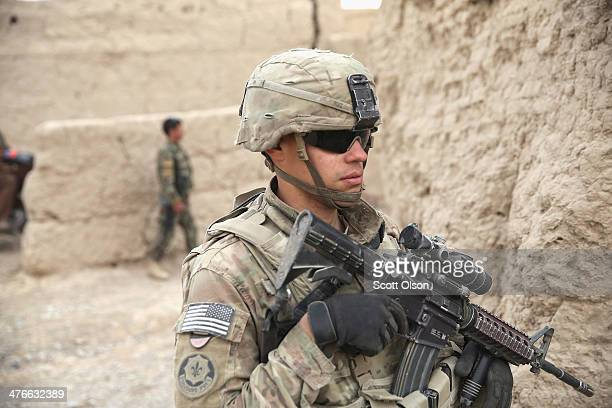 Paul Ruiz from Newark New Jersey with the US Army's 4th squadron 2d Cavalry Regiment participates in a joint patrol through a village with soldiers...