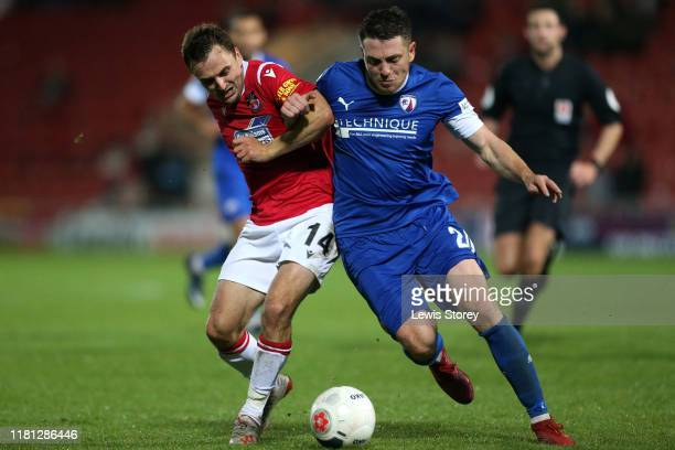 Paul Rutherford and Sam Wedgbury battle for possession during the Vanarama National League match between Wrexham and Chesterfield at the Racecourse...