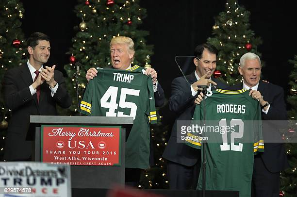 Paul Ryan speaker of the US House of Representatives gives PresidentElect Donald Trump a Green Bay Packers jersey as Wisconsin Governor Scott Walker...