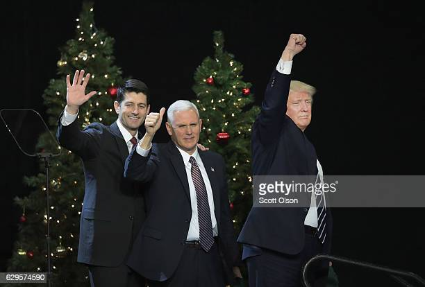 Paul Ryan , speaker of the U.S. House of Representatives, Vice President-Elect Mike Pence , and President-Elect Donald Trump leave the stage after...