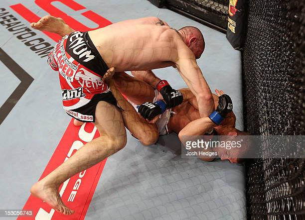 Paul Sass punches Matt Wiman during their lightweight fight at the UFC on Fuel TV event at Capital FM Arena on September 29, 2012 in Nottingham,...