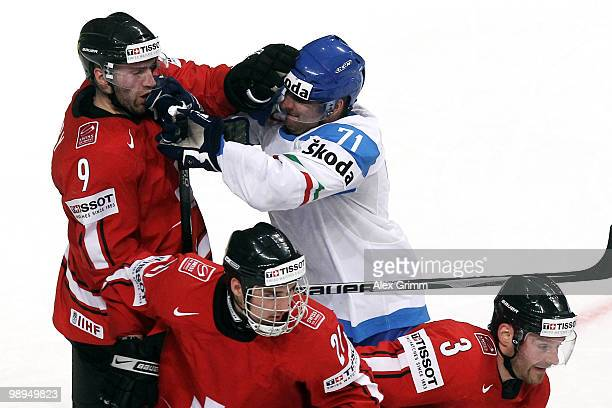 Paul Savary of Switzerland fights with Luca Ansoldi of Italy during the IIHF World Championship group B match between Switzerland and Italy at SAP...