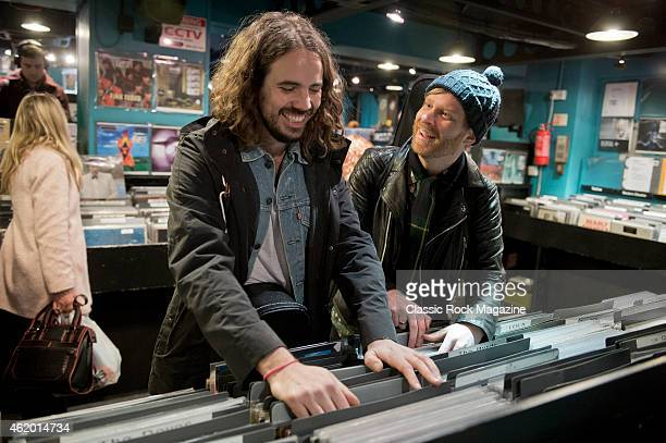Paul Sayer and Luke Potashnick of British blues rock group The Temperance Movement photographed looking through vinyl records at Sister Ray Records...