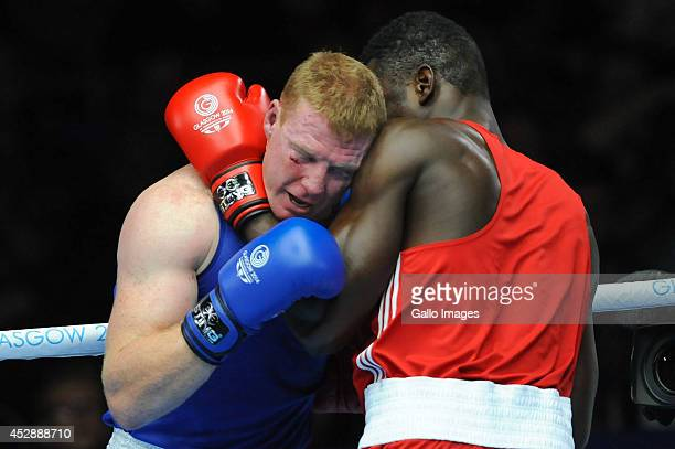Paul Schafer of South Africa and Efe Ajagba of Nigeria compete in the Mens Super Heavy boxing during day 6 of the 20th Commonwealth Games at the...