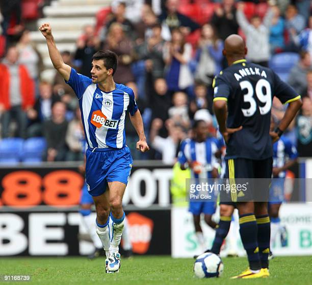 Paul Scharner of Wigan Athletic celabrates scoring during the Barclays Premier League match between Wigan Athletic and Chelsea at DW Stadium on...