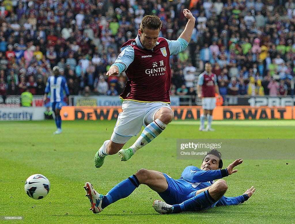 Paul Scharner of Wigan Athletic tackles Andreas Weimann of Aston Villa during the Barclays Premier League match between Wigan Athletic and Aston Villa at DW Stadium on May 19, 2013 in Wigan, England.