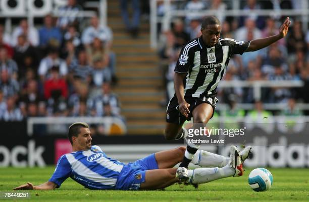 Paul Scharner of Wigan tackles Charles N'Zogbia of Newcastle has a shot on goal during the Barclays Premier League match between Newcastle United and...