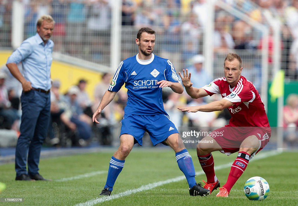 Paul Schletzke of Jena and Maximilian Beister battle for the ball of Hamburg during the DFB Cup between SV Schott Jena and Hamburger SV at Ernst-Abbe-Sportfeld on August 04, 2013 in Jena,Germany.