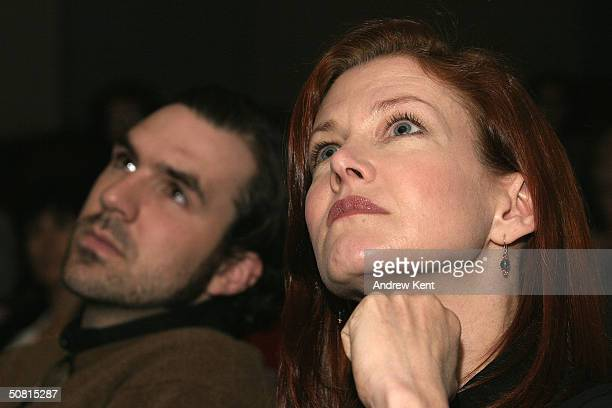 Paul Schneider and actress Haviland Morris listen at the Unraveling The Code Rosalind Franklin and DNA panel during the 2004 Tribeca Film Festival...