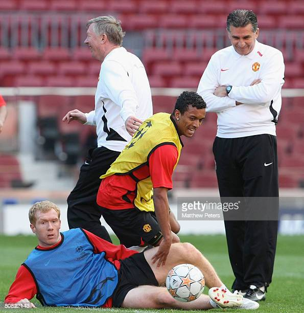 Paul Scholes and Nani of Manchester United in action during a first team training session ahead of their UEFA Champions League semifinal first leg...