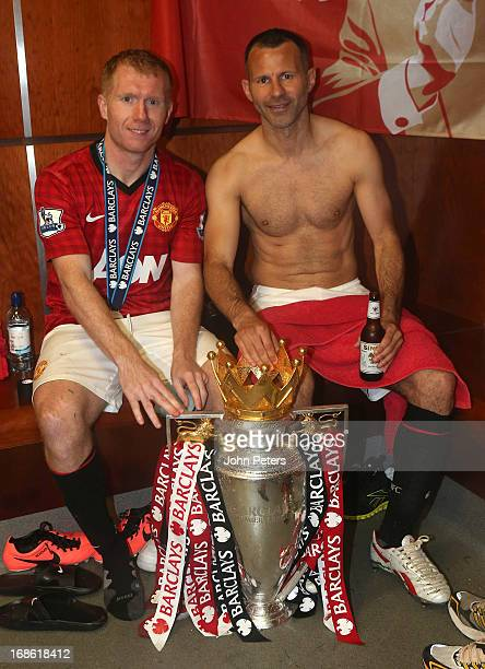 Paul Scholes and Ryan Giggs of Manchester United celebrates with the Barclays Premier League trophy in the dressing room after the Barclays Premier...
