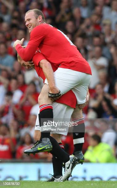 Paul Scholes celebrates scoring their first goal during Paul Scholes' Testimonial match between Manchester United and New York Cosmos at Old Trafford...
