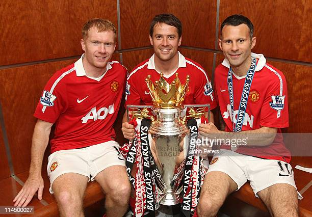 Paul Scholes Michael Owen and Ryan Giggs of Manchester United pose in the dressing room with the Barclays Premier League trophy after the Barclays...