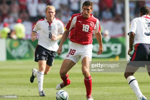 Paul SCHOLES of England and Benjamin HUGGEL of Switzerland during the European Championship match between England and Switzerland at Estadio Cidade...