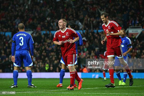 Paul Scholes of Great Britain and Ireland celebrates after scoring the opening goal during the David Beckham Match for Children in aid of UNICEF...