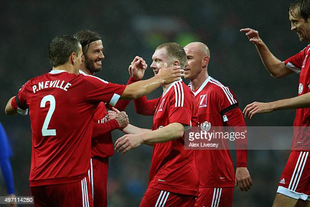 Paul Scholes of Great Britain and Ireland is congratulated by teammates after scoring the opening goal during the David Beckham Match for Children in...