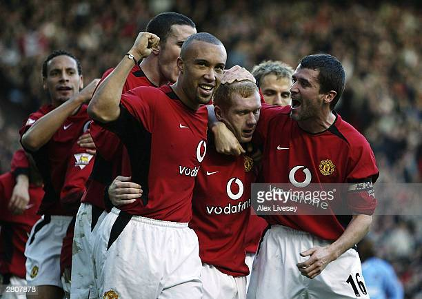 Paul Scholes of Man Utd celebrates with Roy Keane Mikael Silvestre and John O'Shea after scoring the third goal during the FA Barclaycard Premiership...
