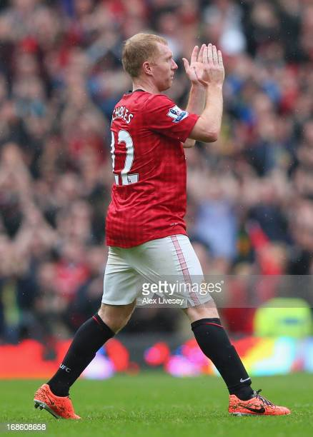 Paul Scholes of Manchester United acknowledges the crowd as he is substituted in his final game for the club during the Barclays Premier League match...