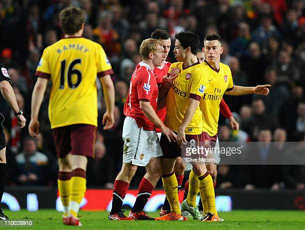 Paul Scholes of Manchester United and Samir Nasri of Arsenal argue during the FA Cup sponsored by E.On Sixth Round match between Manchester United...