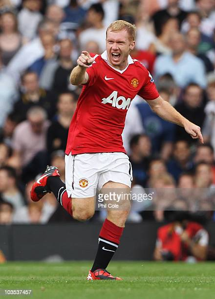 Paul Scholes of Manchester United celebrates as he scores their first goal during the Barclays Premier League match between Fulham and Manchester...