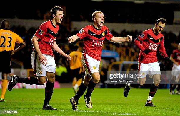 Paul Scholes of Manchester United celebrates scoring his team's first goal and his 100th Premier League goal during the Barclays Premier League match...