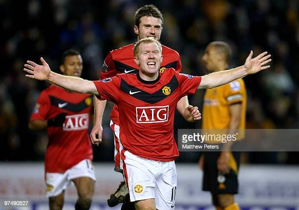 Paul Scholes of Manchester United celebrates scoring his team's first goal and his 100th Premier League goal during the FA Barclays Premier League...
