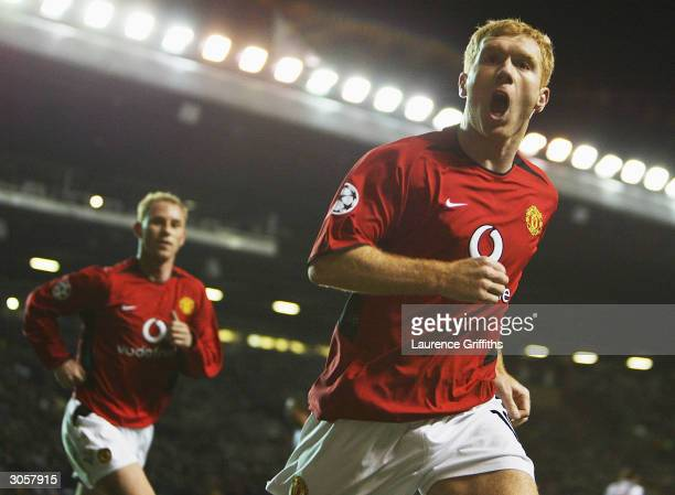 Paul Scholes of Manchester United celebrates scoring the opening goal during the UEFA Champions League match between Manchester United and FC Porto...