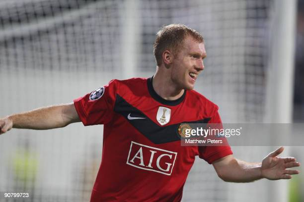 Paul Scholes of Manchester United celebrates scoring the opening goal of the UEFA Champions League match between Besiktas and Manchester United at...