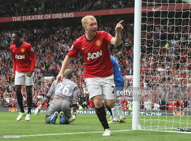 Paul Scholes of Manchester United celebrates scoring their first goal during the Barclays Premier League match between Manchester United and Wigan...