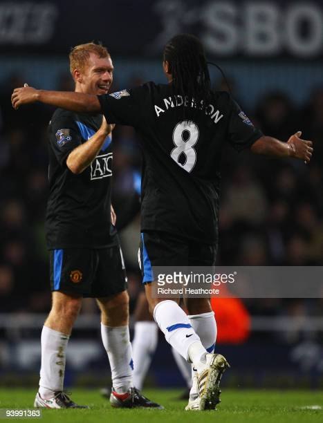 Paul Scholes of Manchester United celebrates scoring their first goal with Anderson during the Barclays Premier League match between West Ham United...