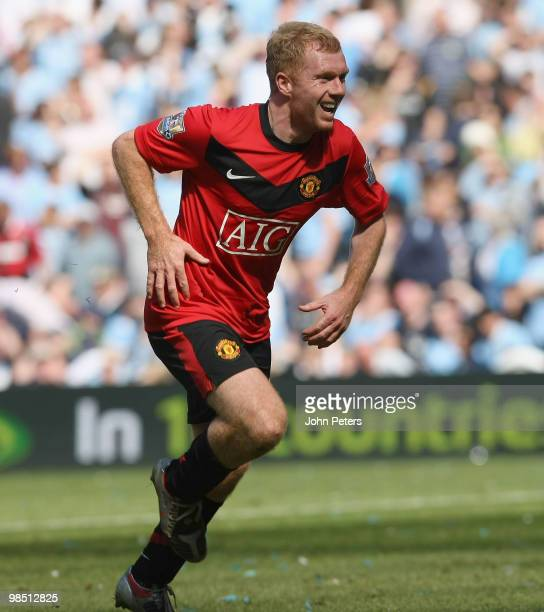 Paul Scholes of Manchester United celebrates scoring their first goal during the Barclays Premier League match between Manchester City and Manchester...