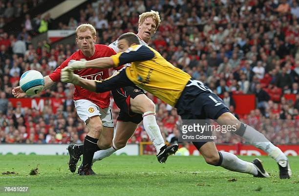 Paul Scholes of Manchester United clashes with Craig Gordon of Sunderland during the Barclays FA Premier League match between Manchester United and...