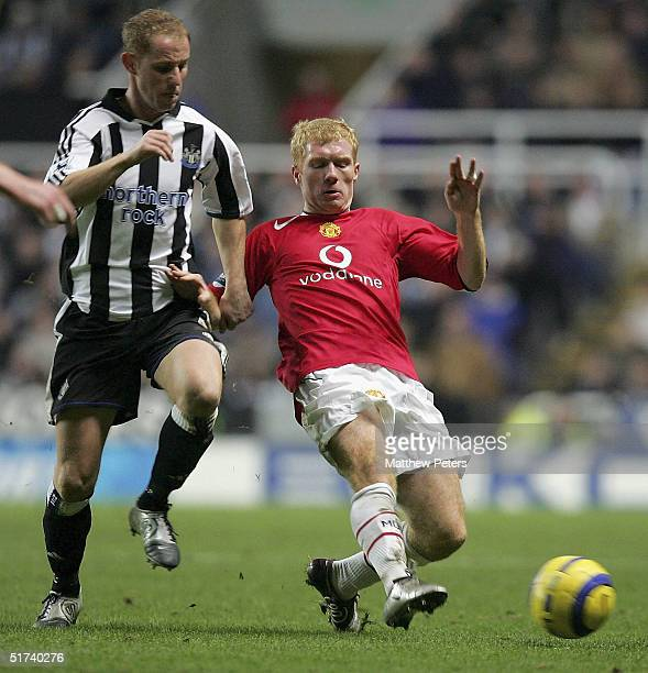 Paul Scholes of Manchester United clashes with Nicky Butt of Newcastle United during the Barclays Premiership match between Newcastle United and...