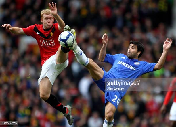 Paul Scholes of Manchester United competes for the ball with Deco of Chelsea during the Barclays Premier League match between Manchester United and...