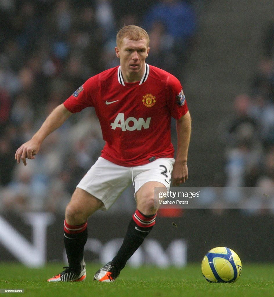 Manchester united fc squad profiles paul scholes of manchester united in action after reversing his decision to retire during the fa voltagebd Images