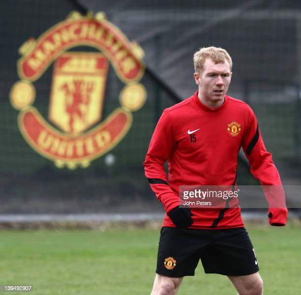 Paul Scholes of Manchester United in action during a first team training session, ahead of their UEFA Europa League round of 32 second leg match...
