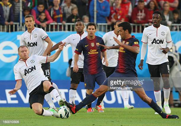 Paul Scholes of Manchester United in action during the preseason friendly match between Manchester United and Barcelona on August 8 2012 in...