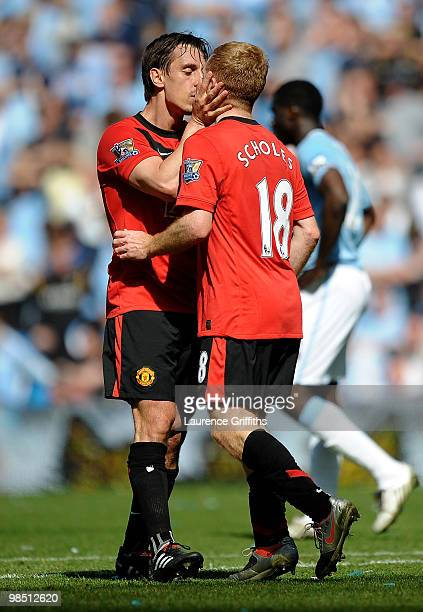 Paul Scholes of Manchester United is kissed by team mate Gary Neville after scoring the winning goal during the Barclays Premier League match between...