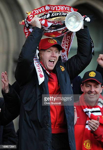 Paul Scholes of Manchester United lifts the Barclays Premier League trophy during the Manchester United Premier League Winners Parade at Manchester...