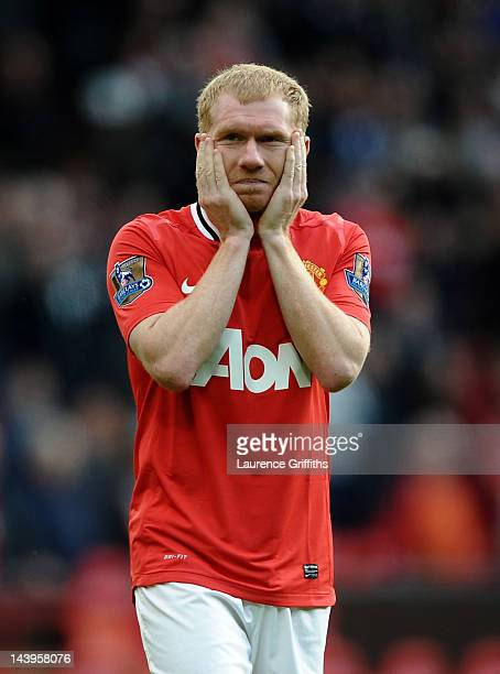 Paul Scholes of Manchester United looks dejected at the end of the Barclays Premier League match between Manchester United and Swansea City at Old...